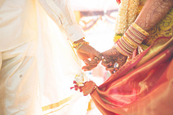 hindu wedding bride and groom celebrating wedding event with flower decorations